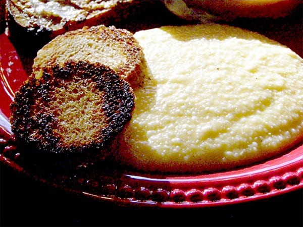 Cheese Grits - Creamy grits with cheddar cheese and a hint of garlic. Part of many a southern breakfast. From @NevrEnoughThyme http://www.lanascooking.com/cheese-grits