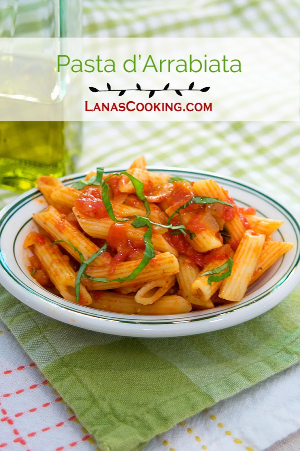 Pasta d'Arrabiata is a delicious combination of pasta, bacon and fiery red pepper flakes with wonderful fresh basil. Top with Parmesan when serving. From @NevrEnoughThyme http://www.lanascooking.com/pasta-darrabiata/