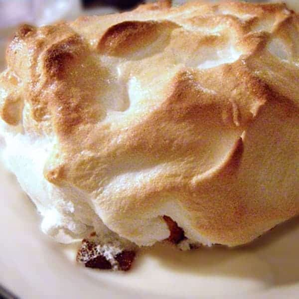 Baked Alaska - A very old-fashioned dessert. Cold ice cream on top of pound cake, covered with warm meringue. Best of both worlds! From @NevrEnoughThyme https://www.lanascooking.com/1960s-flashback-baked-alaska/
