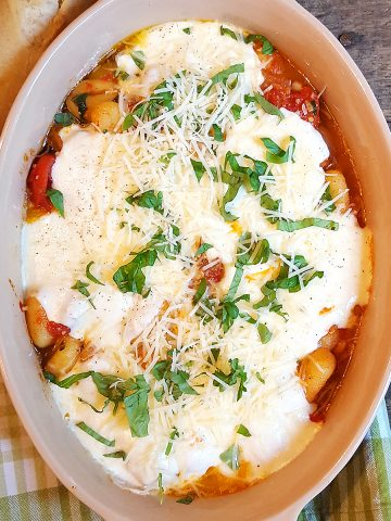 Gnocchi with Tomato Sauce - soft, pillowy gnocchi in a rich tomato sauce, topped with gooey mozzarella cheese. Kids love it! https://www.lanascooking.com/gnocchi-with-tomato-sauce/