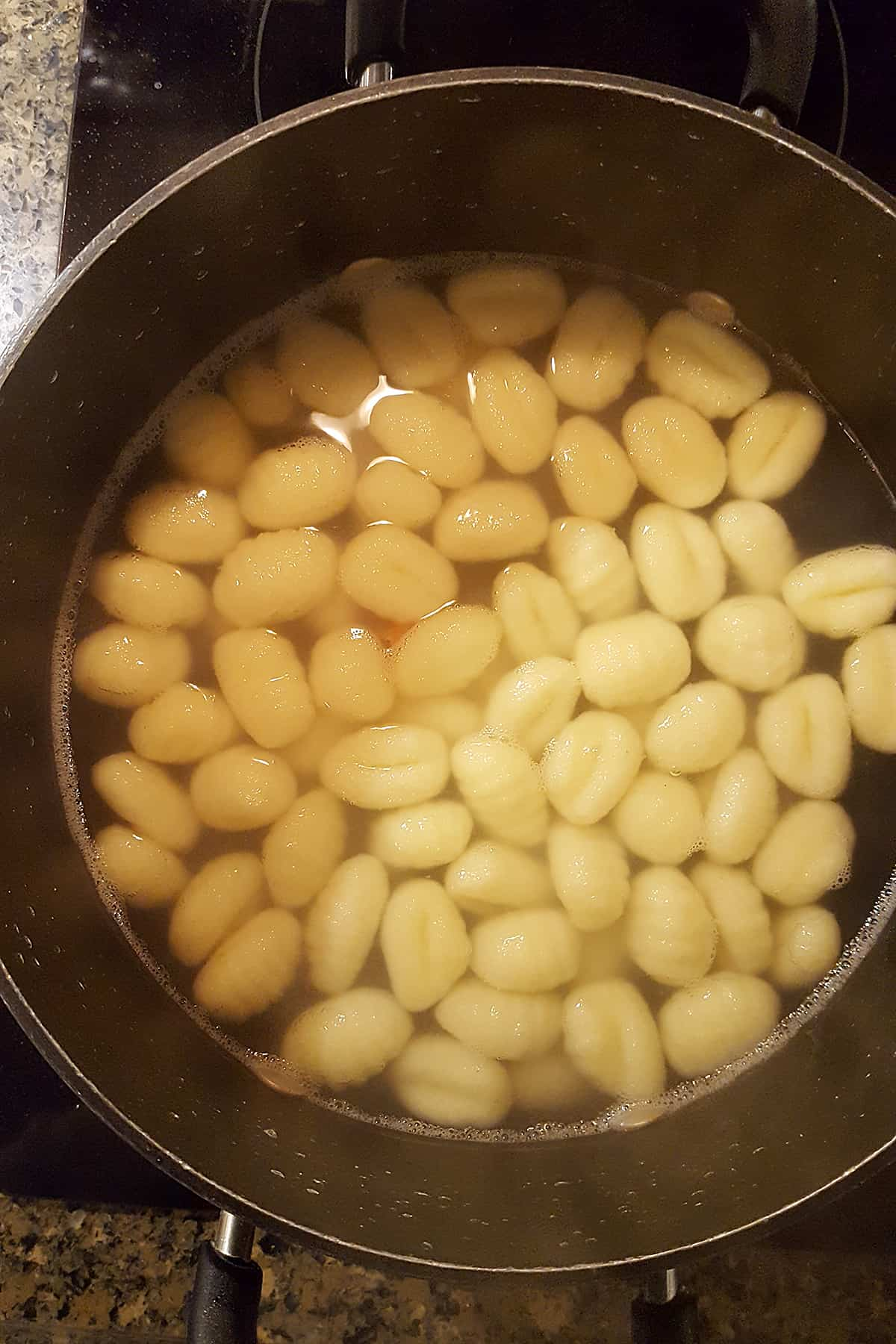 Gnocchi in salted boiling water.
