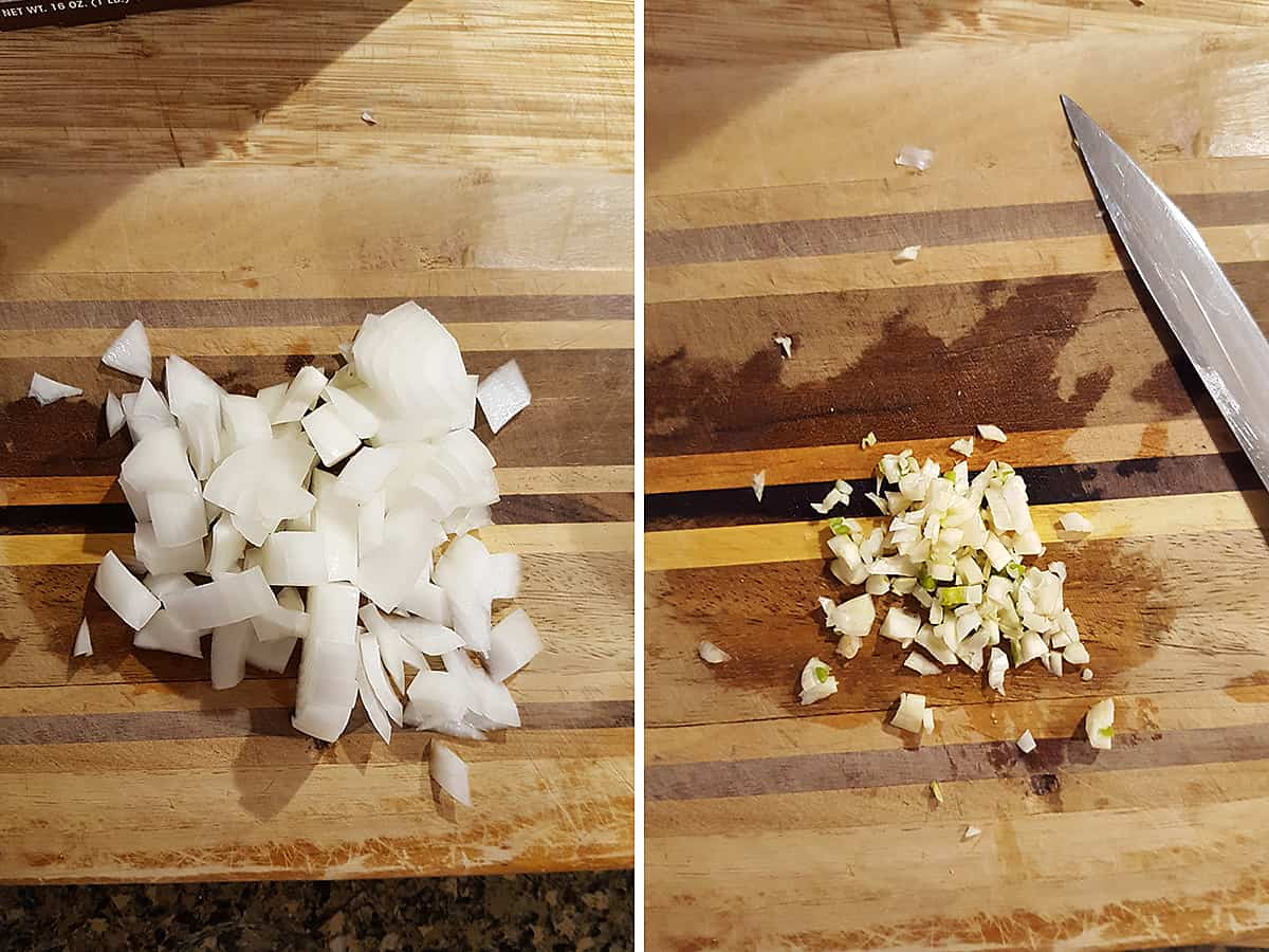 Cutting board and knife with chopped onion and minced garlic.