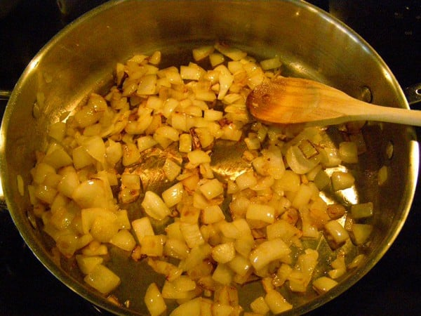 Cook onions for Gnocchi with Tomato Sauce