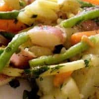 Potato and Green Bean Salad - A lovely, light, and fresh combination of potatoes, beans, carrots, and roasted tomatoes. Great for weeknight dinners. https://www.lanascooking.com/potato-and-green-bean-salad/