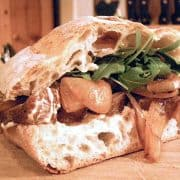 A luscious Steak Sandwich piled high with grilled onions, a spicy mustard mayo, and arugula on ciabatta bread. A meal all on its own. https://www.lanascooking.com/steak-sandwich/