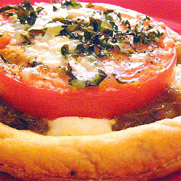 Tomato and Goat Cheese Tarts - Delightful tomato and goat cheese tarts made with purchased puff pastry, fresh tomatoes, goat cheese, and fresh basil. From @NevrEnoughThyme http://www.lanascooking.com/tomato-and-goat-cheese-tarts