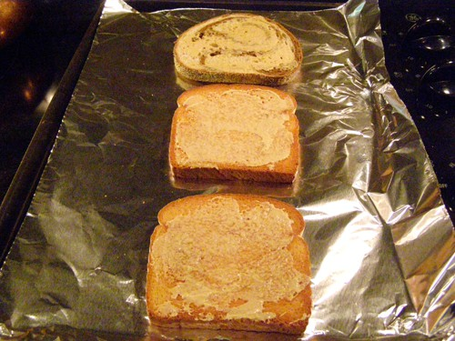 Toasted bread brushed with butter.
