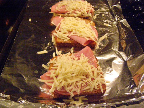 Ham topped with Gruyere cheese.