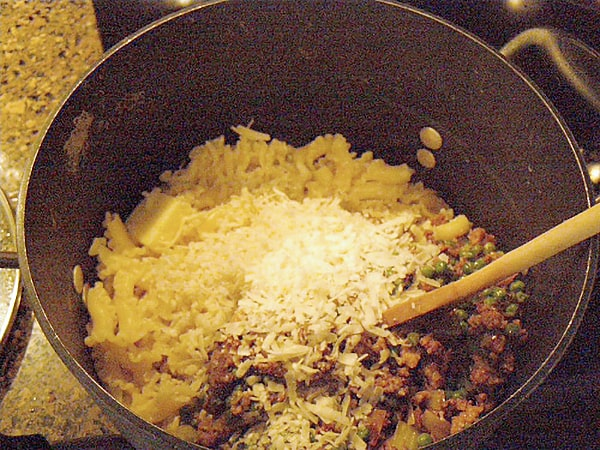 Combine sauce and campanelle for Pasta with Sausage and Leeks