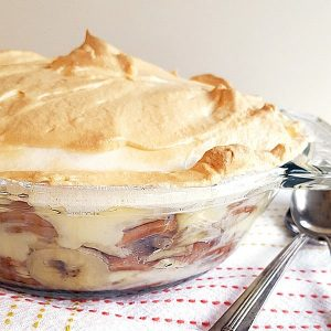 The original and best Banana Pudding recipe. Layers of luscious vanilla custard, crunchy vanilla wafers, and sliced bananas topped with a golden meringue. https://www.lanascooking.com/the-real-deal-banana-pudding/