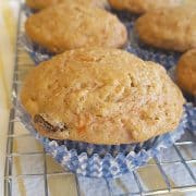 Low Fat Carrot Raisin Muffins - a fantastic, sweet muffin made with yogurt, egg substitute, and applesauce. A favorite for breakfast and afternoon snacks. https://www.lanascooking.com/carrot-raisin-muffins/