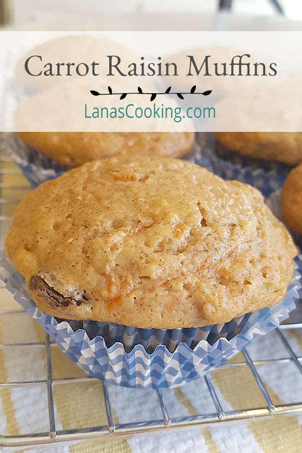 Low Fat Carrot Raisin Muffins - a fantastic, sweet muffin made with yogurt, egg substitute, and applesauce. A favorite for breakfast and afternoon snacks. From @NevrEnoughThyme https://www.lanascooking.com/carrot-raisin-muffins/
