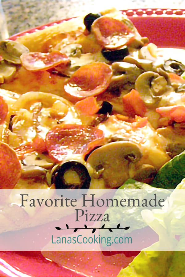 Favorite Homemade Pizza - easy to make homemade pizza dough with our favorite pepperoni and mozzarella cheese toppings. From @NevrEnoughThyme https://www.lanascooking.com/favorite-homemade-pizza/