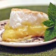 Classic Lemon Meringue Pie - tart, sweet, and perfect for summer. Perfect for summer picnics and makes a sweet ending for warm weather dinners https://www.lanascooking.com/lemon-meringue-pie/