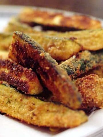"""Zucchini Fries are a great way to use extra zucchini! These """"fries"""" are coated with bread crumbs and Parmesan and baked until golden brown. From @NevrEnoughThyme https://www.lanascooking.com/zucchini-fries/"""