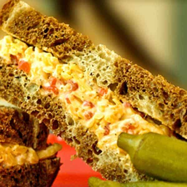Pimiento Cheese is a true Southern classic with its sharp cheddar cheese, pimiento peppers, and mayonnaise. Use it as a sandwich filling or a spread. From @NevrEnoughThyme https://www.lanascooking.com/pimiento-cheese/