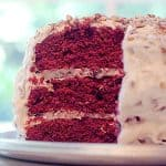 This classic Red Velvet Cake features chocolate layers colored red and slathered with loads of cream cheese frosting studded with pecans. From @NevrEnoughThyme https://www.lanascooking.com/red-velvet-cake/