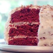 This classic Red Velvet Cake features chocolate layers colored red and slathered with loads of cream cheese frosting studded with pecans. https://www.lanascooking.com/red-velvet-cake/