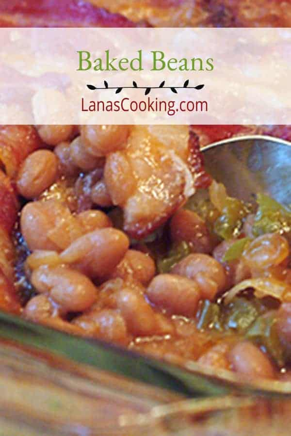Luscious baked beans baked under a layer of bacon. Perfect side dish for barbecued spare ribs, or any summertime cookout. From @NevrEnoughThyme https://www.lanascooking.com/baked-beans/