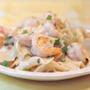Creamy shrimp and pasta - succulent shrimp in a creamy Parmesan sauce served over egg noodles. https://www.lanascooking.com/creamy-shrimp-and-pasta/