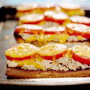 Classic tuna melt - a kicked-up tuna sandwich on toasted ciabatta bread with tomatoes and cheddar cheese! From @NevrEnoughThyme http://www.lanascooking.com/tuna-melt/