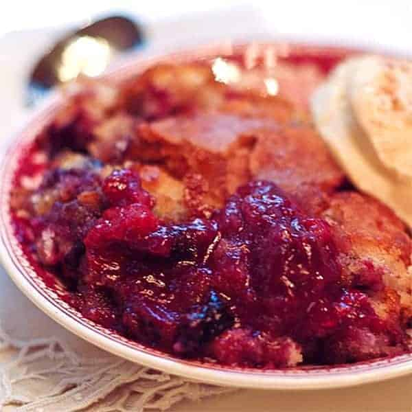 Mixed Berry Cobbler - warm from the oven cobbler of strawberries, blueberries, raspberries and blackberries. From @NevrEnoughThyme https://www.lanascooking.com/mixed-berry-cobbler/