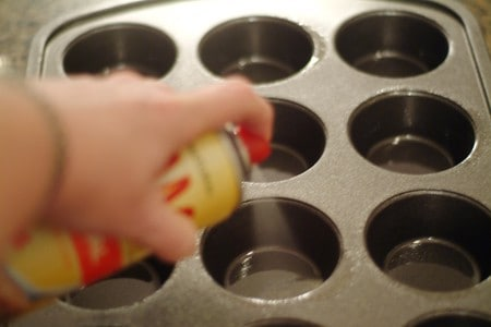 Spray muffins pans with cooking spray for Chili Cheese Corn Muffins