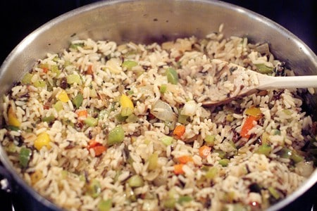 Drained, cooked rice added to the skillet.