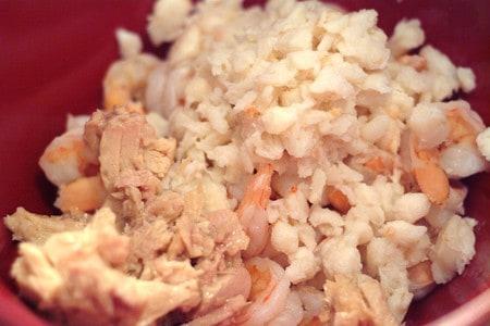 Combining shrimp, crab, and tuna.