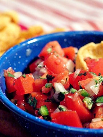 Classic Pico de Gallo - a traditional accompaniment for many Mexican dishes and a great football game snack! Serve with tortilla chips or corn chips. https://www.lanascooking.com/pico-de-gallo/