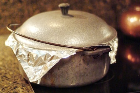 Dutch oven sealed with foil and lid.