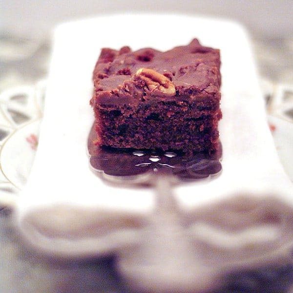 Texas Sheet Cake is a rich chocolate sheet cake spread with a delicious chocolate and pecan icing. https://www.lanascooking.com/texas-sheet-cake/