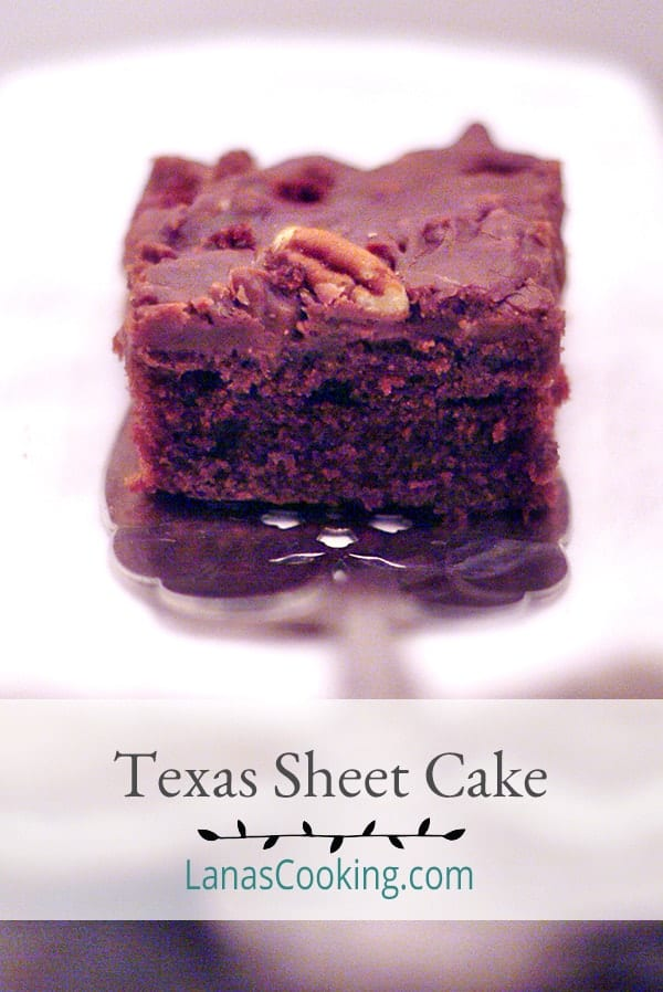 Texas Sheet Cake is a rich chocolate sheet cake spread with a delicious chocolate and pecan icing. From @NevrEnoughThyme https://www.lanascooking.com/texas-sheet-cake/