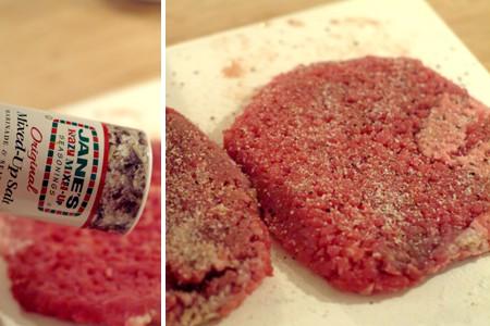 Adding seasonings to cubed steak.