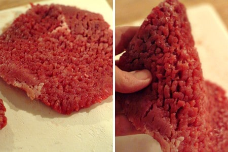 Pieces of cubed steak on a cutting board.