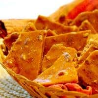 This Cinnamon Pumpkin Seed Brittle swaps out the traditional peanuts for pumpkin seeds and adds a little cinnamon. A nice extra for Thanksgiving dinner. https://www.lanascooking.com/cinnamon-pumpkin-seed-brittle/