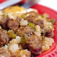 Sausage Potato Hash is loaded with smoked sausage, hash browns, and peppers for a fantastic breakfast treat! From @NevrEnoughThyme https://www.lanascooking.com/sausage-potato-hash-and-100th-post-giveaway/