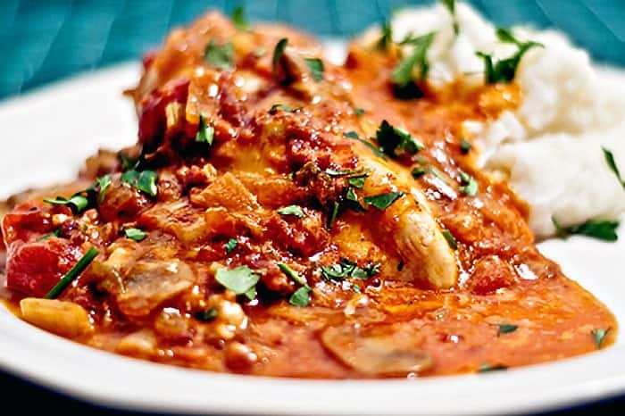 Bistro Chicken is chicken simmered in a tomato and mushroom sauce topped with cheese and bacon. From @NevrEnoughThyme http://www.lanascooking.com/bistro-chicken