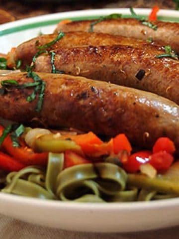 Italian Sausage and Peppers - a fantastic family meal. From @NevrEnoughThyme https://www.lanascooking.com/italian-sausage-and-peppers