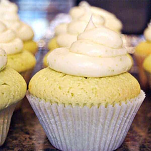 Luscious lime cupcakes with a lime and cream cheese frosting. From @NevrEnoughThyme https://www.lanascooking.com/lime-cupcakes/