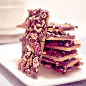 A stack of pieces of Saltine Cracker Toffee on a serving plate.