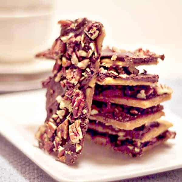 """These Toffee Bars, also known as """"Redneck Toffee"""" are a delicious chocolate and pecan toffee made with a surprising ingredient! From @NevrEnoughThyme https://www.lanascooking.com/toffee-bars-a-k-a-redneck-toffee/"""