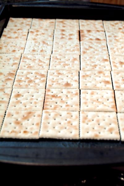 Line the baking sheet with saltine crackers