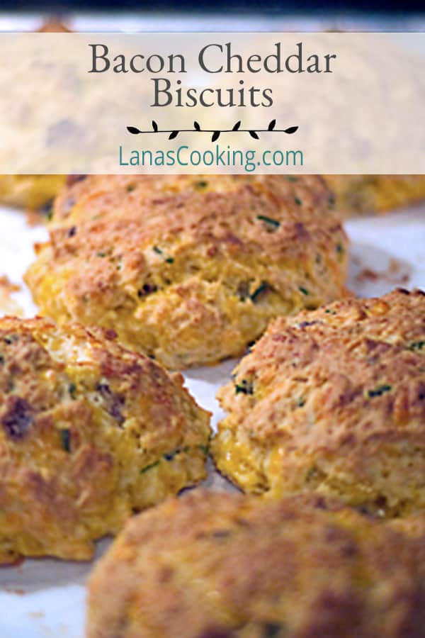Bacon Cheddar Biscuits - a classic buttermilk biscuit with the addition of bacon, cheddar cheese, and chives. From @NevrEnoughThyme https://www.lanascooking.com/bacon-cheddar-biscuits/