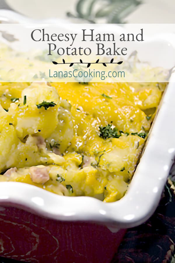 Cheesy Ham and Potato Bake is just good, old fashioned comfort food. Ham, cheese and potatoes combined in an oven-baked dish. From @NevrEnoughThyme https://www.lanascooking.com/cheesy-ham-and-potato-bake/