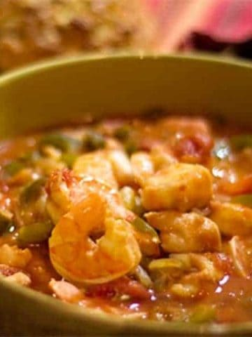 A quick and easy Seafood Stew of shrimp, cod, tomatoes and veggies. From @NevrEnoughThyme https://www.lanascooking.com/seafood-stew/
