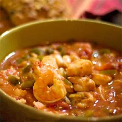 A quick and easy Seafood Stew of shrimp, cod, tomatoes and veggies. From @NevrEnoughThyme http://www.lanascooking.com/seafood-stew/