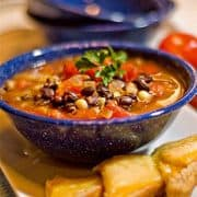 Black and White Bean Soup - Black and navy beans combined in a beefy, tomato broth for a substantial dinner soup. https://www.lanascooking.com/black-white-bean-soup