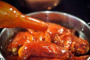Add sauce and chicken to pan for Smothered Barbecued Chicken