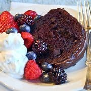Berry Glazed Chocolate Cake - a moist devil's food cake topped with a raspberry glaze and chocolate icing. Perfect for any celebration. https://www.lanascooking.com/berry-glazed-chocolate-cake/